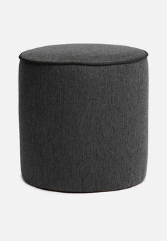 Urban ottoman - piping detail/ plain dark grey. If you're on the lookout for a few quick fixes with a big impact that don't break the bank, consider this modern furniture option. It's a stylish ottoman with a cylindrical shape, and a solid colouring apart from a slim piping detail around the top edge.