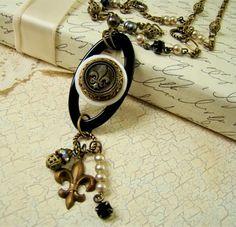 Antique Fleur de lis Button Pearls Rhinestone Assemblage Necklace http://www.etsy.com/listing/87369649/antique-fleur-de-lis-button-pearls