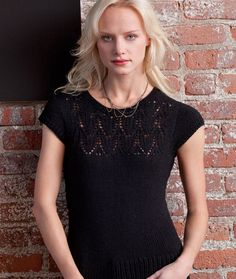 Hotness Top from Redheart - With a silhouette that flatters the figure, this lacy-yoked, black top proves that knit lace isn't always prim and proper. It's a stunning night-out look in black, but other colors can be used for a more feminine mood. Pattern