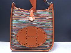 $3950 HERMES ORANGE VIBRATO EVELYN MESSENGER BAG @Steve Mack #maxpawn #hermes #lasvegashandbags www.bagpawn.com