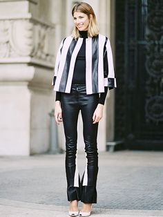 Black and white striped jacket, black top, and black leather pants with white panel