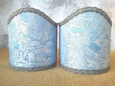 Couple of lampshades decorated with gorgeous Brocade textured fabric with floreal patterns, finished with antique Silver precious trim. 69,00 €