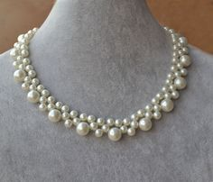 I make the flower necklace to use 6mm and 10mm glass pearls.You can choose the pearl colour.The necklace lengh is 15 inches or 16 inches .IT has a 2 inches long adjustable chain, IT is good necklace for your great wedding.  I can make different type necklace to your requirements,Please feel free to contact me if you have any question.  Thank you so much.  :)