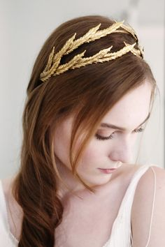 Feel like a goddess on your big day in a golden crown. #wedding #accessories #headband