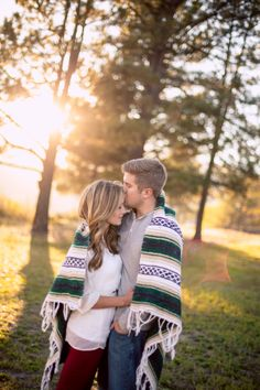 Keeping each other warm in the sunshine with the help of a close embrace + a stylish blanket. Becca + Jeff