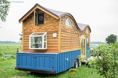 The colorful Perquod tiny house from Rocky Mountain Tiny Homes. A 208 sq ft tiny house on wheels that comfortably fits a family of four.