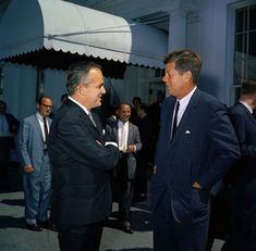 President John F. Kennedy speaks with Prince Ranier of Monaco after a luncheon in honor of the Prince and his wife, Princess Grace.