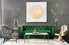 green sofa + painted brick wall + bold art + oversized vases