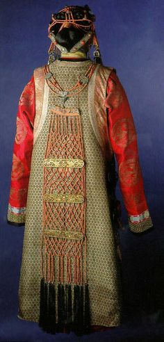 Mongolian woman's costume with red coral and silver jewelry | Mongolian costumed mannequin in the National Museum, Copenhagen, Denmark. Danish ethnographer Henning Haslund-Christensen collected these artefacts in 1936-37 during his visit to Mongolia on behalf of the National Museum of Denmark. | ©Miguel C, via Flickr