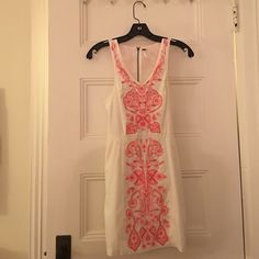 Free people embroidered cotton bodycon Perfect vacation or spring dress! Cotton bodycon with light magenta and neon embroidery. Worn three times-wish it still fit me! Could do with a steam but otherwise like new. Free People Dresses Mini