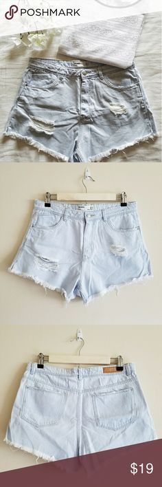 """ZARA High-Rise Cutoff Shorts Light blue high rise jean shorts. Has two """"destroyed"""" patches on front. MEASUREMENTS LAYING FLAT: approx. 2.5"""" inseam/ 13.5"""" length. In excellent condition! Reasonable offers are very welcomed :) Zara Shorts Jean Shorts"""