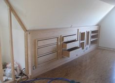 knee wall with storage drawers (looks like the ones we have on the other side already)