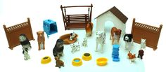 This set comes with 27 pieces, including a dog house, fences, swing, food bowls, crate, bed, dogs and puppies.  For ages 5 and up.