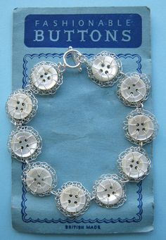 ButtonArtMuseum.com - Bracelet: Vintage Mother of Pearl Buttons (100 years old). Each iridescent button is individually handstitched with fine silver wire. Photographed on vintage button card / Judith Brown Jewelry