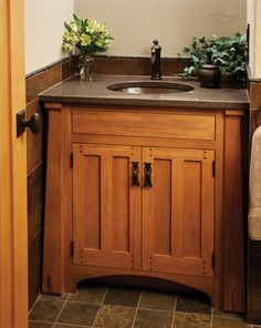 Vanity with Ellsworth door (U.S. Design Patent #US D668,082 S) in Antique Chestnut with a natural finish - Arts & Crafts Designer Series - CrownPoint Cabinetry