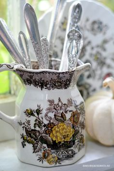 Brown Transferware pitcher holding vintage flatware | homeiswheretheboatis.net #fall #table #pottingshed