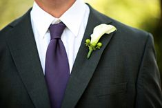 dark grey suits for groomsmen with purple ties, I think this looks classy. The grey really brings out the purple