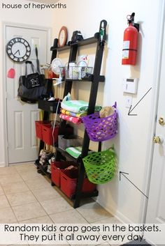 mudroom storage - hang baskets on the wall to collect kids' stuff.