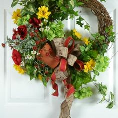 Lovely summer door wreath with a garden filled clay pot.