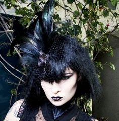 black feather fascinator hat birdcage veil- Nevermore Gothic Exotic Taxidermy Avian Bird Hat in Black with Veil. $650.00, via Etsy.