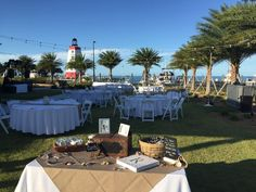 Wedding Reception Setup on the Yacht Club Event Lawn with a perfect backdrop of our iconic Lighthouse! #Lighthouse #FaroBlanco #Wedding #Reception #Setup #Waterfront #FLKeys #Beautiful