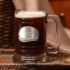Glass Mug - Groomsman...These heavy weight, clear, glass mugs can be personalized on a genuine pewter plate that calls out the groomsman title.    Raising a toast with beautiful glassware not only shows your sense of style, but it offers you a reminder of your special day every time you use it.