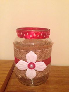 Jar covered in hessian and ribbon