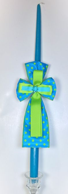 """This 18"""" teal candle features a polka dot theme with teal/green ribbon and gem.  ~WE CAN SHIP DIRECTLY TO YOUR GODCHILD~ Please provide shipping address during checkout. A gift notecard will be included. Leave your message in the NOTES section. Our candles are meticulously packaged with bubble wrap and paper to ensure the candles do not move during shipping. Variations to the ribbons, flowers, style and design may occur because they are seasonal and customized items."""
