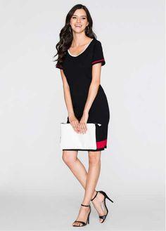 Bekijk nu:Minimalistisch elegante jurk in recht model met ronde hals en korte mouwen. De mouwen en de onderrand zijn contrastkleurig afgewerkt.