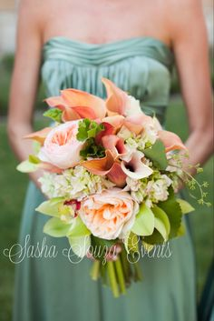Daily Pretty: Lush peach, apricot, minty green and sage toned bridesmaids bouquet with garden roses, calla lilies, cymbidium orchids, galax leaf, hydrangea, scented geranium leaf, and seeded eucalyptus.  Image by Tu Photography.