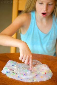 3 ingredient easy baking soda slime recipe without borax that's fun for your kids to make! Simple and safe to play with that you can make colorful too!