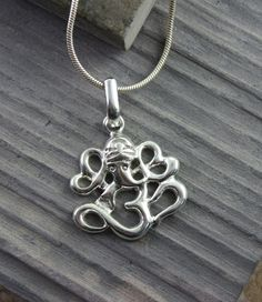 Dharmashop.com - Ganesh Om Pendant, $12.99 (http://www.dharmashop.com/ganesh-om-pendant/)
