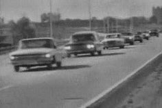 11/25/63 - Lee Harvey Oswald's funeral procession to Fort Worth from Dallas.