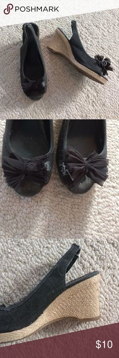 No flaws!! Dark charcoal canvas wedges Canvas wedges with tulle bow on the toes. Elastic strap along the back of the angle. Woven wedge. Only worn a few times so they are like new! New York & Company Shoes
