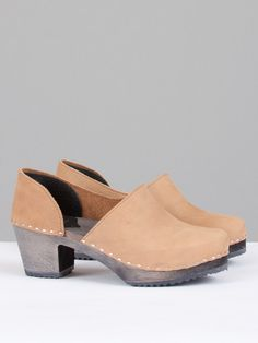 Creatures of Comfort x Sandgrens Brett Clogs are medium heeled clogs with a round toe, double seam at inner foot. Features a cut out detailing on the outer shoe. Rubber grip sole. Heel measures at 2.25 inches from back. 100% leather and wood.