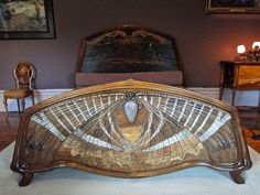 I think I was meant to live in the art nouveau era...  This is a sphinx moth bed built in 1904, part of a photo tour of a French magistrate's home shared by Alexandre Prévot.