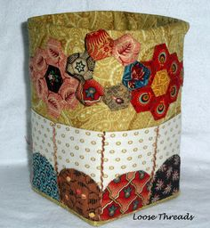 Loose Threads: Hexagon Thread Catcher and Needlebook  made over a milk bottle.  Also, a hexie needle case