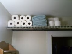 use shower curtain rods to hang wire shelves - without putting holes in your wall