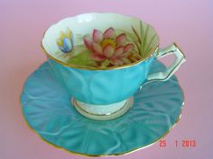 Gold Trimmed AYNSLEY Turquoise Blue with Water Lilies Teacup & Saucer duo.