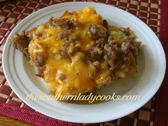 HASH BROWN & SAUSAGE BREAKFAST CASSEROLE Recipe Breakfast and Brunch with frozen hash browns, onion, green pepper, bacon, sausages, meat, eggs, salt, pepper, garlic powder, shredded cheddar cheese, oil