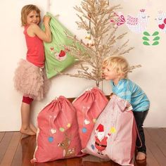 Santa sacks. I like the idea of leaving old toys for santa to take and fix up and give to other kids. Great way to get kids to give away old toys!