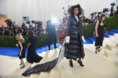 Staying afloat! Solange wore an eye-catching Thom Browne coat, complete with a matching dress