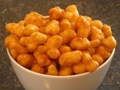 Caramel Puff Corn....To Die for!!    1 (8 ounce) bag puff corn  1 cup butter (do not substitute)  1 cup brown sugar  ½ cup light corn syrup  1 teaspoon baking soda   Bake at 250 for 1 hr.  stirring every 15 minutes....totally worth it!!