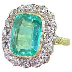 Edwardian 6.00 Carat Minor Oil Colombian Emerald Old Cut Diamond Ring
