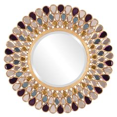 Add a stylish touch to any space with his mirror. A jewel-inspired frame highlights this Grace mirror.