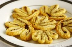 "Pesto palmiers are quick and easy appetizers for an elegant party. I made these pesto palmiers bite-sized so that they would work well at a dinner party we\'re hosting tonight. I have to thank Rianne from Art of Dessert for her post that reminded me of how to make them. As she said, palmiers look incredibly fancy, but in reality are quite easy to make. On top of that, the puff pastry ""logs"" of palmiers can be frozen for later use. If you\'re storing frozen pesto cubes as I\'ve suggested in…"