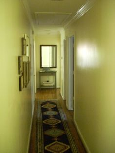 """Interior hallway """"before."""" """"A Ranch House Transformation"""" This home was completely remodeled without adding a single square foot and stayed on budget. @TheWillsCompany"""