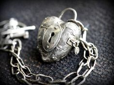 New! Padlock Heart Locket necklace. Solid sterling silver heavy weight construction. This locket features an opening latch that reveals the inside of the locket. Carved on the inside is do not enter with spiderwebs. Open space is available to stick a secret youd like to keep locked up. The heart shown here comes with a 19 hammered handmade chain complete with a matching toggle and a key charm in solid sterling silver to match. This locket is a full 1/2 inch deep and solid built. Copyrig...
