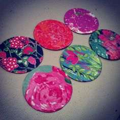 DIY Lilly Pulitzer coasters for the dorm. Just modge podge old Lilly agenda pages onto circular pieces of cork!