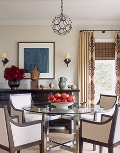 Designed by Chad Eisner, this dining room features a glass and nickel-plated metal table designed by Eisner himself. And the pendant light is from Reborn Antiques.  Dominique Vorillon photo
